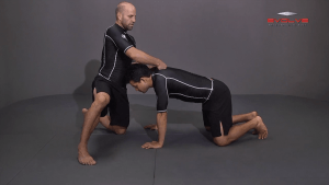 Front Headlock To Spin Behind Arm Block