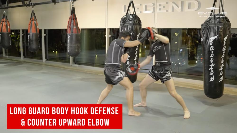 Long guard body hook defense & counter upward elbow